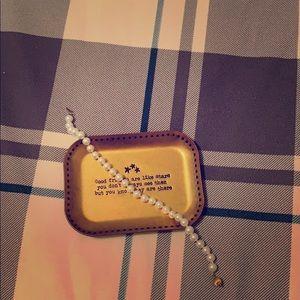 Pearl bracelet.